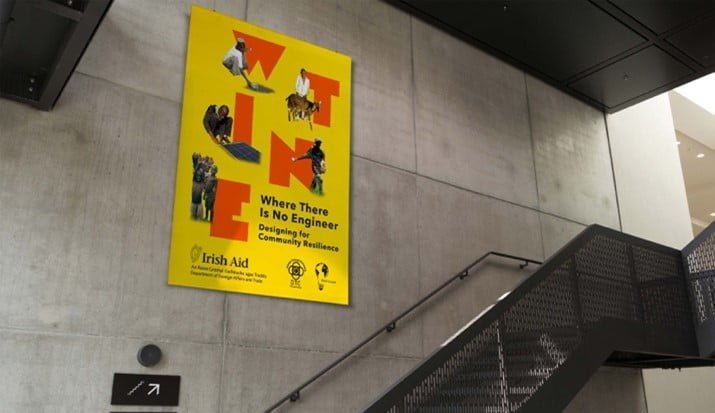 a yellow poster on a wall
