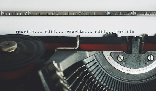 a close up of an old fashioned typewriter with script on a page