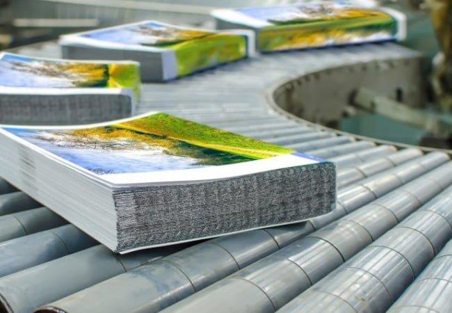 freshly printed books on a printing shop conveyor belt